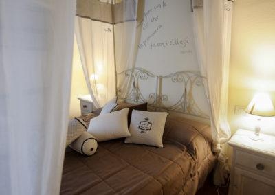 Camera con letto a baldacchino nel Resort